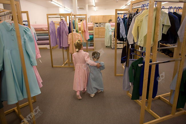 """Fundamentalist Mormon group F.L.D.S.,  girls looking through clothing section of the Storehouse on the """"Yearning for Zion"""" compound in Eldorado, Texas, USA, February 12, 2009"""