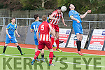 Heads Up<br /> -------------<br /> Mastergeeha Gear&oacute;id Kerins connects perfect with the ball from a corner kick with Michael Wren, Strand Rd, Tralee getting in the way.