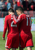 30 March 2013:Toronto FC midfielder Luis Silva #11talks with Toronto FC midfielder Jonathan Osorio #21 after scoring his goal during an MLS game between the LA Galaxy and Toronto FC at BMO Field in Toronto, Ontario Canada..The game ended in a 2-2 draw..