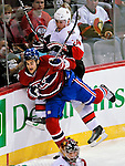 17 October 2009: Montreal Canadiens left wing forward Max Pacioretty is checked into the boards by defenseman Anton Volchenkov at the Bell Centre in Montreal, Quebec, Canada. The Senators defeated the Canadiens 3-1. Mandatory Credit: Ed Wolfstein Photo