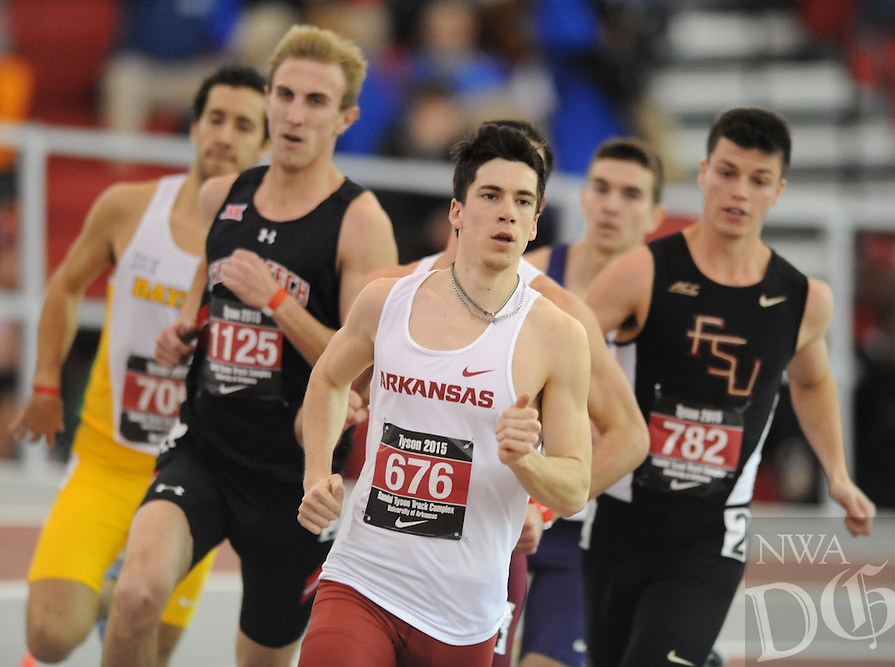 NWA Democrat-Gazette/ANDY SHUPE - Tomas Squella of Arkansas leads the field while competing in the 800 meters during the Tyson Invitational Friday, Feb. 13, 2015, at the Randal Tyson Track Center in Fayetteville.