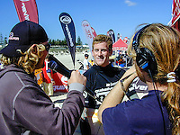 Matt Hoy (AUS) interviews Brett Hardy (AUS).Cottesloe Beach, Perth, Western Australia, Saturday August 18 2001..A round of  The Quiksilver Airshow International Series, with $20,000 in prize-money was run today at Cottesloe Beach. The Quiksilver Airshow is the richest and most spectacular surfing event to be staged at a Perth Beach. The contest is based around the futuristic moves of aerial surfing, where each surfer  is judged on their best two aerial manoeuvres in each heat. (Photo: joliphotos.com)