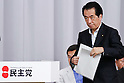 June 28th, 2011, Tokyo, Japan - Beleaguered Japanese Prime Minister Naoto Kan walks to the podium for addressing a party caucus as the ruling Democratic Party of Japan calls on a general assembly of its members at the Diet in Tokyo on Tuesday, June 28, 2011. Defining for the first time conditions for fulfilling his June 2 pledge to resign, Kan said on Monday he would resign after the passage of three key bills - the second reconstruction budget, the renewable energy bill and the bond-issuance bill. Kan has been under pressure from both the opposition and his own Democratic Party of Japan to step down over his poor handling of the March 11 earthquake and tsunami that caused the biggest nuclear catastrophe in 25 years. (Photo by AFLO) [3609] -mis-...