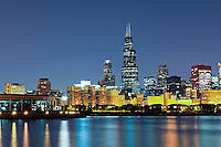 Chicago lakefront at night downtown city skyline with Willis Tower (Sears Tower) and Shedd Aquarium.