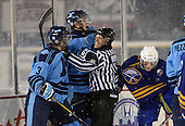 Linesmen Lenny Valvo steps in between St. Michaels Buzzers defensemen Luca Doctor (3) and Buffalo Junior Sabres forward Josh Gabriel (13) during the Frozen Frontier outdoor game at Frontier Field on December 15, 2013 in Rochester, New York.  Second St. Michaels player is unidentified.  St. Michael's defeated Buffalo 5-4.  (Copyright Mike Janes Photography)