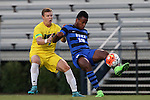 15 September 2015: Duke's Jeremy Ebobisse (19) and UNCW's Michael Mecham (3). The Duke University Blue Devils hosted the University of North Carolina Wilmington Seahawks at Koskinen Stadium in Durham, NC in a 2015 NCAA Division I Men's Soccer match. UNCW won the game 3-0.