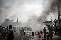 In this Wednesday, Aug. 14, 2013 photo, smoke rises from the sit-in during clashes between supporters of the ousted president Mohammed Morsi with security forces in streets around Al-Raba'a Alawya mosque in the Nasr district of Cairo. (Photo/Narciso Contreras).