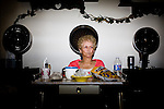 Billie McGriff at the hair Salon in the border town of Palomitas, Arizona...Scenes from the US-Mexico Border between Douglas and Nogales, Arizona.  The high, arid landscape dividing these two frontier towns serves as a major portal for undocumented immigrants as well as a thoroughfare for human and drug trafficking.  The Bush administration approved 2.7 billion dollars for the construction of a fence along the 2000 mile border area.  The fence is not contiguous and, at many points, shows obvious signs that it serves only as a hurdle not as a roadblock.  The Obama administration has yet to decide whether it will complete construction of the fence which, even according to its mandate, will not bridge the entire border, rather covering urban and high-traffic areas.  .