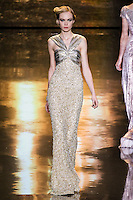 Siri Tollerød walks runway in an outfit from the Badgley Mischka Fall 2011 fashion show, during Mercedes-Benz Fashion Week Fall 2011.