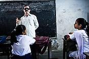 A teacher from the Devanga community, M. Kesav Rao takes a class in Mahesh Sri Potti Sri Ramulu Andhra High Schhol in Mahesh, Hooghly in West Bengal, India.  Photo: Sanjit Das/Panos for The Wall Street Journal. Slug: ICASTE