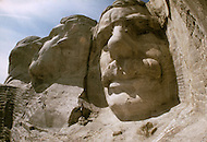 Mount Rushmore National Memorial (US National Park) as documented on May 2nd, 1986 by photographer Jean Pierre Laffont as part of an assignment for the book 'A Day in the Life of America' published by Collins - Photographer Jeane Pierre Laffont can be seen in center frame
