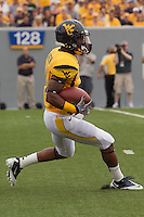 WVU inside receiver Tavon Austin. The WVU Mountaineers beat the Marshall Thundering Herd 34-13 in a game called just after the fourth quarter started because of severe thunderstorms in the area. The game was played at Milan Puskar Stadium in Morgantown, West Virginia on September 4, 2011.