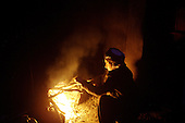 BIARA, IRAQ: Yahia Salah (15) lights a fire to heat water for the hamam--traditional bathroom...The Biara Madrassa--a religious school--is located high up in the mountainous Kurdish Hawraman region that makes up the Iran/Iraq border. Before 2003 the region was home to a fundamentalist Islamic group called Ansar al-Islam who used the school as a base. The Unites States military attacked the area and the madrassa numerous times during the 2003 invasion, finally pushing Ansar al-Islam out...Today the madrassa is home to 48 male students from all across Kurdish Iraq. The students leave their families and immerse themselves in their studies and the daily life of Koranic students...Photo by Besaran Tofiq