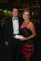 Upper Hutt mayor Wayne Guppy with Fiona Couchman from Masterpet, which won the Team Gold Award. Wellington Gold Awards at TSB Bank Arena, Wellington, New Zealand on Thursday, 9 July 2015. Photo: Dave Lintott / lintottphoto.co.nz