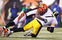 Ben Roethlisberger #7 of the Pittsburgh Steelers is sacked by Vontaze Burfict #55 of the Cincinnati Bengals in the second half during the Wild Card playoff game at Paul Brown Stadium on January 9, 2016 in Cincinnati, Ohio. (Photo by Jared Wickerham/DKPittsburghSports)