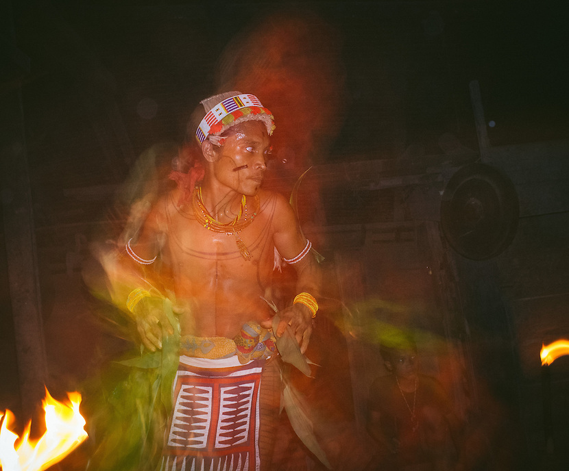 "Aman Lepon performing ""turuk laggai"", the Mentawai traditional dance. The Mentawai are the tribes living traditionally in the island of Siberut, Indonesia. Here, where the changes came slow, some of the people are still living like their ancestors did centuries ago. They s till practice ancient religion called Arat Sabulungan, which believe that everything in the forest has a spirit."