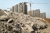 A building site in Hebei, on the outskirts of Beijing, where rural land is increasingly destroyed to make way for urbanisation. <br /> <br /> China is pushing ahead with a dramatic, history-making plan to move 100 million rural residents into towns and cities over six years &mdash; but without a clear idea of how to pay for the gargantuan undertaking or whether the farmers involved want to move.<br />