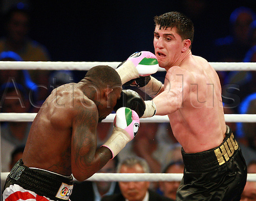 08.06.2013. Berlin, Germany.  German WBO cruiserweight world champion Marco Huck (R)and his British challenger Ola Afolabi fight for the world championship title at Max-Schmeling-Hall in Berlin, Germany, 08 June 2013. Huck won and retains the title.