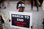 "A girl holds a sing during a silent march to end the ""stop-and-frisk"" program in New York June 17, 2012.  Photo by Kena Betancur / VIEWpress.."