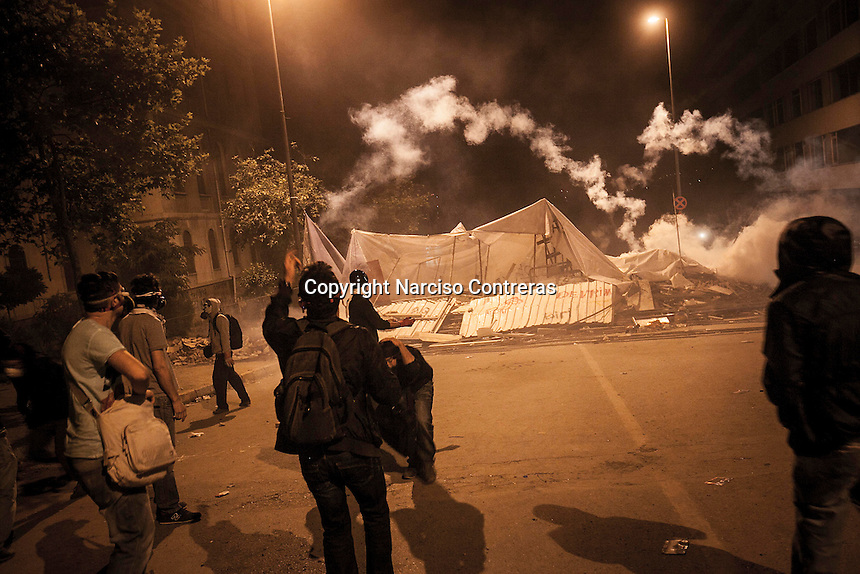 Protesters clash to the the anti-riot police in streets nearby Taksim Square during a masive rally against the turkish government in Istanbul, Turkey.