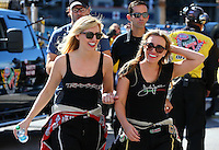 Nov 2, 2014; Las Vegas, NV, USA; NHRA funny car driver Courtney Force (left) with sister top fuel driver Brittany Force during the Toyota Nationals at The Strip at Las Vegas Motor Speedway. Mandatory Credit: Mark J. Rebilas-USA TODAY Sports