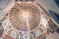 Domed painted ceiling of the women's prayer hall in the Green Mosque or Yesil Cami, Bursa, Turkey. The Green Mosque was built under Sultan Mehmed Celebi in 1419-21 by the architect Haci Ivaz Pasha. The painted decorations were by Ali bin Ilyas and Mehmed el Mecnun. Following an earthquake in 1855, the building underwent an extensive renovation led by architect Leon Parvillee. Picture by Manuel Cohen