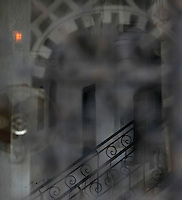 Medina, Tangier, Morocco pictured on December 27, 2009. An atmospheric view of a staircase with wrought iron bannister rail, see through a screened window. Tangier, the 'White City', gateway to North Africa, a port on the Straits of Gibraltar where the Meditaerranean meets the Atlantic is an ancient city where many cultures, Phoenicians, Berbers, Portuguese and Spaniards have all left their mark. With its medina, palace and position overlooking two seas the city is now being developed as a tourist attraction and modern port. Picture by Manuel Cohen