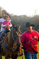 Family on horseback, Haiku, Maui