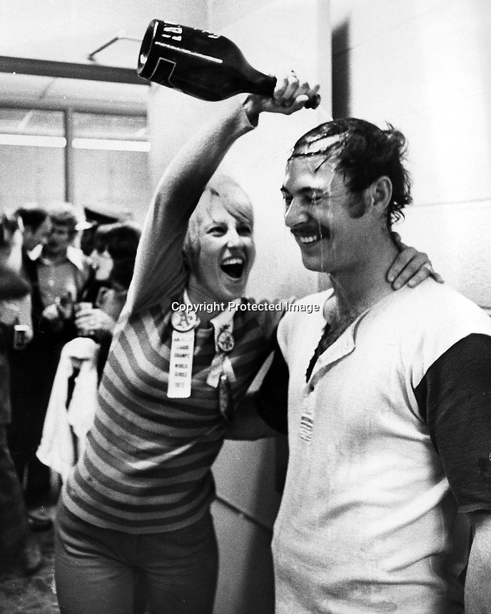 Oakland Athletics Gene Tenace gets a champane shower from his wife after the A's had just beat the Cincinnati Reds in the 1972 World Series.<br />