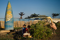 Boys hunt for grasshoppers near the ruins of a restaurant and posada on Venezuela's Paraguaná Peninsula, Dec. 12, 2015. The remote desert peninsula in the Caribbean Sea lays bare the effects of Venezuela's politicized economy after 17 years under Hugo Chavez and successor Nicolas Maduro.