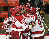 Chris Huxley (Harvard - 28), Alex Killorn (Harvard - 19), Alex Fallstrom (Harvard - 16), Marshall Everson (Harvard - 21) and Danny Biega (Harvard - 9) celebrate Everson's goal. - The Harvard University Crimson defeated the St. Lawrence University Saints 4-3 on senior night Saturday, February 26, 2011, at Bright Hockey Center in Cambridge, Massachusetts.