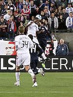 Toronto FC midfielder Martin Saric (25) and New England Revolution defender Kevin Alston (30) compete for a high ball.  The New England Revolution defeated Toronto FC, 4-1, at Gillette Stadium on April 10.2010