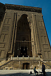 Cairo, Egypt -- The entrance to the Sultan Hassan mosque dwarfs a local backgammon game. © Rick Collier / RickCollier.com.
