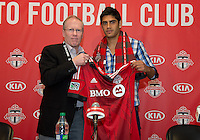 27 April 2013: Toronto FC President and General Manager Kevin Payne presents Toronto FC Designated Player Matias Laba to the media during a press conference before an MLS game between the New York Red Bulls and Toronto FC at BMO Field in Toronto, Ontario Canada....
