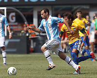 Argentina midfielder Javier Mascherano (14) dribbles as Brazil forward Neymar (11) closes. In an international friendly (Clash of Titans), Argentina defeated Brazil, 4-3, at MetLife Stadium on June 9, 2012.