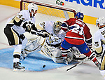21 September 2009: Pittsburgh Penguins' goaltender John Curry makes a second period save during a pre-season game against the Montreal Canadiens at the Bell Centre in Montreal, Quebec, Canada. The Canadiens edged out the defending Stanley Cup Champions 4-3. Mandatory Credit: Ed Wolfstein Photo