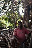 A traditional boat builder making the pirogue fishing boats.