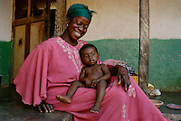 Yaa Tatyia with her grandchild Yaw Eric in the village of Bayerobon 3, Western Ghana..