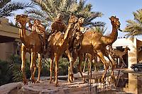 Dubai, United Arab Emirates. Royal Mirage Hotel.  Camel Courtyard.  Camel sculptures by Danie de Jager..
