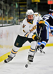 2 December 2011: University of Vermont Catamount defenseman Nick Bruneteau, a Sophomore from Omaha, NB, in action against the University of Maine Black Bears at Gutterson Fieldhouse in Burlington, Vermont. The Catamounts fell to the Black Bears 6-4 in the first game of their 2-game Hockey East weekend series. Mandatory Credit: Ed Wolfstein Photo