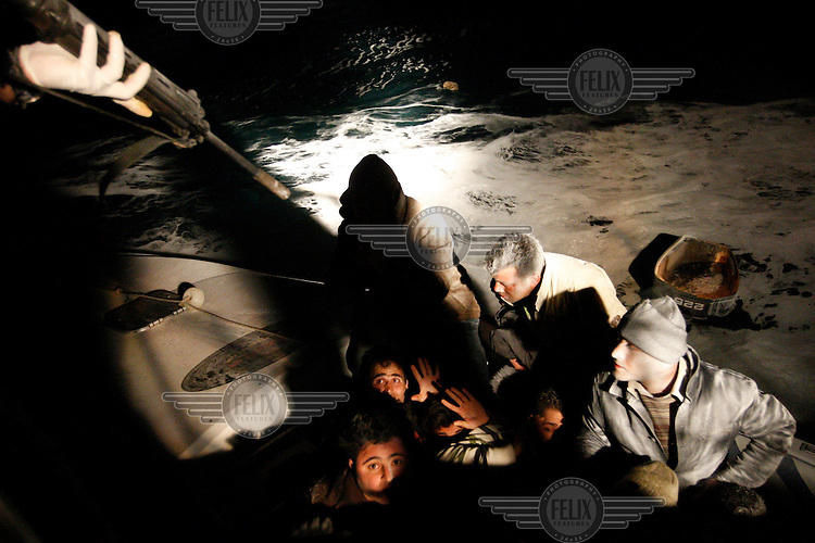 Greece/ Agathonisi /April 17,2009.  During a night patrol in Agathonisi island, men of the Greek Coast Guard apprehend a boat with 16  immigrants, who were trying to cross the Aegean Sea. During the night long operation, they had to shoot to the engine of the speedboat and two smuglers were arrested. Agathonisi which has their destination is less than 9 miles away from Turkey. The Greek-Turkish (sea and land) borders are of particular interest as they constitute, today, the main entry route to southeast Europe for thousands aliens. Groups of bedraggled men, women and children from as far away as Afghanistan, Syria, Iraq, Somalia and various countries in Asia, the Middle East and Africa arrive daily with the hope to find a better future. Hundrends have drowned in the Aegean Sea, that has come to be characterized as an aquatic grave for immigrants. Giorgos Moutafis