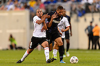F.C. Internazionale Milano forward Ishak Belfodil (7) is marked by Valencia C. F. midfielder Sofiane Feghouli (8). Valencia C. F. defeated F.C. Internazionale Milano 4-0 during round two of the 2013 Guinness International Champions Cup at MetLife Stadium in East Rutherford, NJ, on August 04, 2013.
