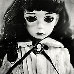 portrait of sad colette the doll