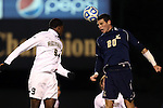24 November 2013: Navy's Joseph Greenspan (20) and Wake Forest's Sean Okoli (9). The Wake Forest University Demon Deacons played the Naval Academy Midshipmen at Spry Stadium in Winston-Salem, NC in a 2013 NCAA Division I Men's Soccer Tournament Second Round match. Wake Forest won the game 2-1.