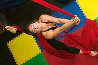 Aerial artist, Rebecca Devi Leonard, of A Girl in the Sky Productions, rehearses on the silks in her warehouse space on Sterling St. Jan. 19.&amp;#xD;<br />