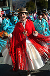 Dancing cholitas, dressed in the traditional indigenous Aymaran clothing of bowler hats, mantas or shawls, and pollera dresses, celebrate a religious festival through the streets of La Paz, Bolivia.