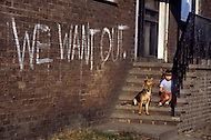 August 1981. Newcastle area, England. Families gather in the streets and parks during the summer months.