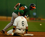 03 Jun 2006 Lincoln, NE Manhattan University's Ryan Marcoux can't handle a throw at second as University of Miami's Tommy Giles would advance to third during the NCAA Baseball Regionals at Haymarket Park in Lincoln, Ne Saturday night.(Chris Machian/Prairie Pixel Group)