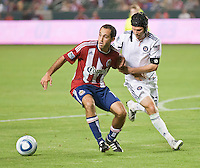 CARSON, CA – July 2, 2011: Chivas USA midfielder Nick LaBrocca (10) and Chicago Fire midfielder Logan Pause (12) during the match between Chivas USA and Chicago Fire at the Home Depot Center in Carson, California. Final score Chivas USA 1, Chicago Fire 1.