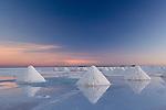 Bolivia, Salar de Uyuni, salt harvesting, sunrise